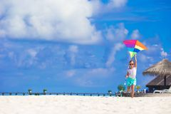 Little happy girl playing with flying kite on Royalty Free Stock Images