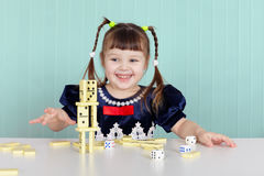 Little happy girl is playing with toys Royalty Free Stock Photos