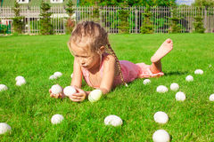 Little happy girl playing with white Easter eggs Royalty Free Stock Photography