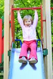 Happy girl plays on the chidish hill Royalty Free Stock Image
