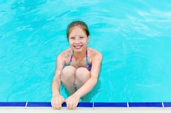 Little happy girl in pool royalty free stock photography