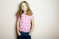 Little happy girl posing in a flower shirt. Royalty Free Stock Photography