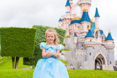 Little happy girl in princess dress at fairy-tale Royalty Free Stock Photo