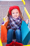 Little happy girl with purchases in hands Royalty Free Stock Images