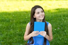 Free Little Happy Girl Reading Book Outdoors Sunny Day, Daydreamer Concept Stock Images - 195655134