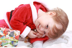 Little happy girl in red santa's clothes Royalty Free Stock Photography