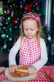 Little happy girl with rolling pins baking Stock Photo
