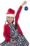 Little Happy Girl in Santa hat hanging Xmas Bubble Royalty Free Stock Photography