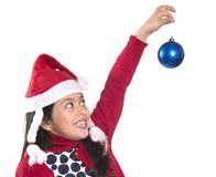 Little Happy Girl in Santa hat hanging Xmas Bubble Stock Photo