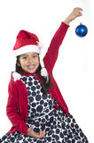 Little Happy Girl in Santa hat hanging Xmas Bubble Stock Photos