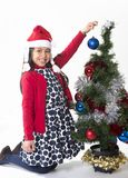 Little Happy Girl in Santa hat hanging Xmas Bubble Stock Image