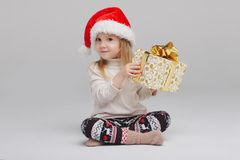 Little happy girl with santa hat Royalty Free Stock Photos