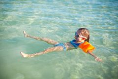 Little happy girl at swimsuit having fun in clear Royalty Free Stock Images