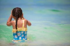 Little happy girl at swimsuit having fun in clear Royalty Free Stock Photography