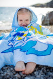 Little happy girl in a towel Royalty Free Stock Photo