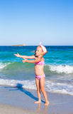 Little happy girl during tropical beach vacation Stock Photography