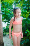 Little happy girl under beach shower on tropical beach. Little cute girl under beach shower on tropical beach Royalty Free Stock Photography