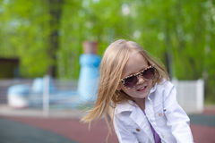 Little happy girl walking outdoor and having fun in park Royalty Free Stock Images