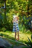 Little happy girl watering garden royalty free stock photos