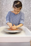 Little happy girl working with potters wheel Royalty Free Stock Photography