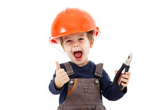 Little happy repairman in hardhat with pliers show thumb up Stock Photo