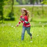 Little happy running girl Royalty Free Stock Photo