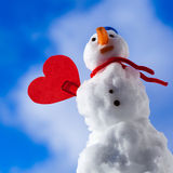 Little happy snowman red heart love symbol outdoor. Winter. Stock Photography