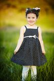Little happy summer girl. With retro dress Royalty Free Stock Photos