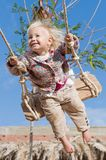 Little happy on a swing Royalty Free Stock Images
