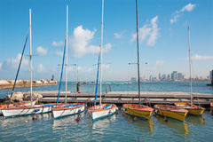 The little harbor and yachts under old Jaffa and Tel Aviv in the backgound in the morning Royalty Free Stock Images