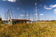 Little harbour behind dunes. And dune gras stock image