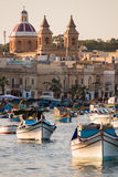 Little Harbour. Colorful boats in front of the scenic porttown Marsaxlokk in Malta Stock Photography