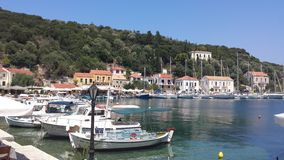 Little harbour in Greece. Beautiful town in Greece with fishing boats stock photography