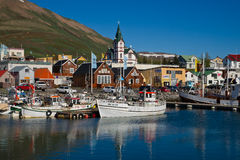 The little harbour of Husavik in Iceland. ICELAND, HUSAVIK - June 9th, 2010: View across the scenic harbour of the northern icelandic smalltown of Husavik at a stock image
