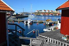 Little harbour. Small harbour in Marstrand, Sweden, with its traditional swedish houses royalty free stock photos