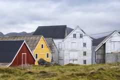 Little harbour in the village Runde, Norway. Old weathered buildings, boathouses, in a little harbour in the village Runde, Norway stock photography