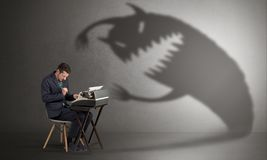 Hard worker afraid of scary monster royalty free stock photography