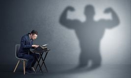 Hard worker afraid of scary monster stock image