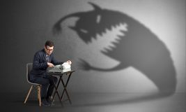 Hard worker afraid of scary monster royalty free stock photo