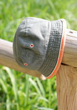 Little hat on wooden fence Stock Photography