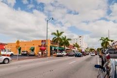 Little Havana. Miami, Florida, USA - November 25, 2011: Tourists go toward the popular Calle Ocho, in Little Havana, Miami, Florida, USA. Calle Ocho is the heart Royalty Free Stock Photography