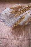 Little heap flour ears of wheat on wooden Royalty Free Stock Photos