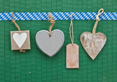 Little hearts on green Stock Image