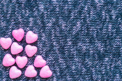 Little hearts on knitted surfaces. Flat lay Stock Images