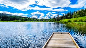Little Heffley Lake in the Shuswap region of British Columbia, Canada. Fishing Dock on Little Heffley Lake, a small fishing lake, at the Heffley-Sun Peaks Road royalty free stock photos