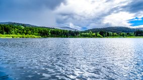 Little Heffley Lake in the Shuswap region of British Columbia, Canada. Little Heffley Lake, a small fishing lake, at the Heffley-Sun Peaks Road in the Shuswap stock images