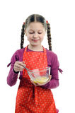 Little helper. An image of a little girl stirring something in a bowl stock images