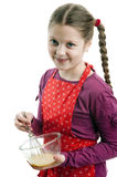 Little helper. An image of a girl with a bowl stock images