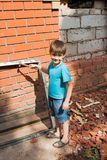 Little helper, boy at work Stock Images
