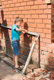 Little helper, boy at work Royalty Free Stock Images